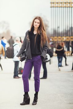 streetstyled: If you aren't already wearing it,...  coat/cover up + purple jeans + boots + socks + shirt + style