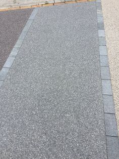 'Storm Grey' Resin-bonded gravel in or aggregate. This product has a guarantee f