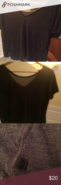 Lululemon crop shirt Grey can be worn either as a v neck or v neck in back. Its short crop like lululemon athletica Tops Tees - Short Sleeve