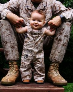 Mini Marine via http://baseguide.com/BaseGuide/CampLejeune/Photos.aspx--this is by far the cutest uniform replica, mini outfit for kids I've seen!!