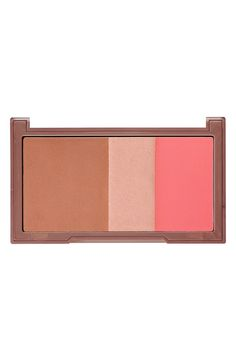 Love the vibrant coral color of this Urban Decay bronzer, highlighter & blush palette!