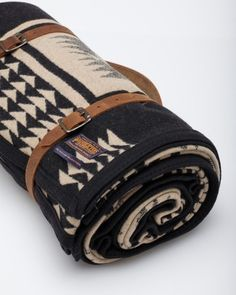 Wool blanket from Pendleton's Portland Collection. Featuring the Native design-that was dedicated to President Harding, with solid trim. Detachable leather harness with buckled straps and shoulder strap gathers blanket.