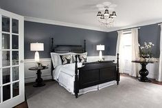 love the wall colors, crisp white linens and black furniture