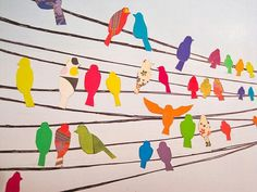 Paper birds. It would be a beautiful backdrop for a bird themed party.