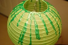 Green slime lantern Halloween decoration: I'm going to buy black lanterns and use red paint to make it look like blood for his Zombie themed Halloween Birthday party!