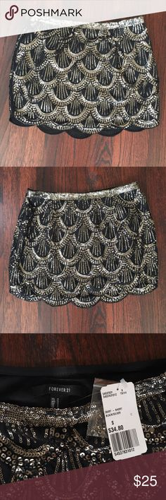 Forever 21 black & silver sequin skirt. Size Small Forever 21 sequin skirt. Size Small. No loose or missing sequins. NWT and includes the pouch of extra sequins that came with it. Forever 21 Skirts Mini