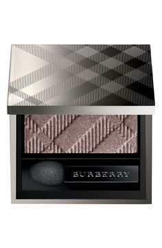 Apply a light sweep of sheer shadow to enhance a natural look