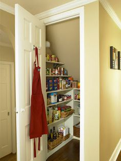 If we buy a house that doesn't have a pantry. Establish an Efficient Pantry. Convert the space under the staircase into a small room for storing food, paper goods, and extra cooking equipment. Add a door and wrap the three walls with shallow shelves. Pantry Cupboard, Pantry Closet, Pantry Storage, Closet Storage, Kitchen Storage, Storage Spaces, Food Storage, Kitchen Pantry, Storage Shelves