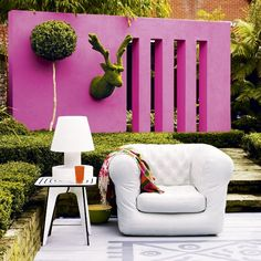 Colourful Garden Wall and Party lounge...make a sophisticated chill-out zone by painting your own rug onto decking. Grouping living room-esque furniture and accessories around it adds to the conceit and makes for stylish alfresco lounging.