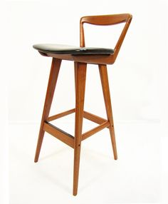 ONLY 2 LEFT  A set of five teak 1960s bar stools by Danish designer Rosengren Hansen for Brande Mobelindustri.   The graceful back supports and stylish tapered legs put these bar stools amongst the best ever designed.   They are in excellent restored condition. The leather is original with only minor signs of wear.   They bear the Brande Mobelindustri manufacturer stamps and labels to the undersides.