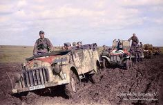 A FlaK unit Kfz.70 Steyr 1500A/01, followed by two Sd.Kfz.10 FlaK 38 vehicles in the Ukraine, 1942