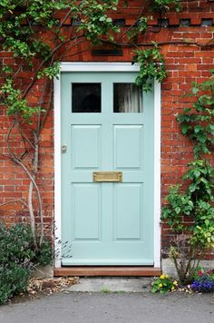 brick exterior wall, light blue door. 'Watery' would also make a beautiful entry door color, especially when surrounded by red brick like this one