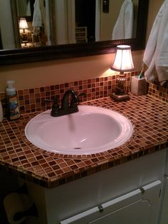 Bathroom counter with glass tiles