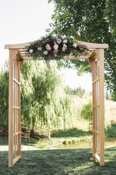 floral swag at the top of the wedding ceremony arch