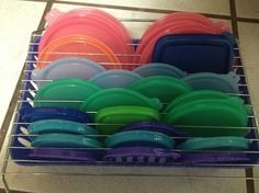 Cooling Rack Over a Dollar Store Basket to Organize Plastic Lids.
