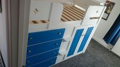 4 Drawer cabin bed in white and royal blue with star cutout front rails. At Aspenn Furniture we make bespoke cabin beds from solid natural woods designed by you, the customer. You design everything from layout & colours to the hinges. As we only use the highest quality solid woods we can structurally guarantee our cabin beds for 20 years, we've never had one break! Visit www.aspennfurniture.co.uk to view more of our work and design your cabin bed. We'll email you back a full quote within a day. Childrens Cabin Beds, Natural Bedding, Cozy Bed, Wood Design, Linen Bedding, Natural Wood, Solid Wood, Dresser, This Is Us