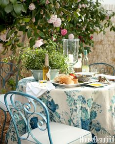 Camellias arch over an outdoor dining table draped with a Clarence House linen, Dahlia, in the backyard of a Pasadena, California, house. <{table cloth and chairs}> Modern Cottage, Romantic Cottage, Cottage Style, Romantic Table, French Cottage, Contemporary Cottage, Romantic Dinners, Farmhouse Style, Outdoor Rooms