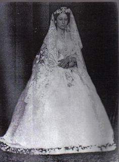 Princess Alice(Queen Victoria's daughter) on her wedding day in 1862.  Her father, Prince Albert , had died less than a year ago.  The veil is the one her daughter , Alexandra, wore on her wedding day to Tsar Nicholas II. Just before Princess Alice's wedding she wore mourning black and right after the wedding she put back on the mourning black.  Queen Victoria and some of Princess Alice's siblings cried during her wedding.