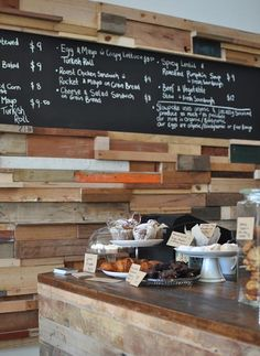 slowpoke cafe by Sasufi_12 metre-long wall covered in timber offcuts