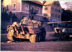 A German tank out of action. (Panzer V Panther). This same small town in Belgium still has this WW2 tank in the exact same spot  condition as the German crew left her...