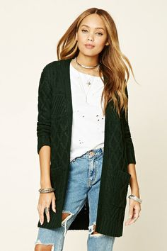 4e3a39cd81 A midweight cable knit cardigan featuring a longline silhouette