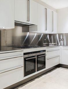 Kitchen with stainless steel splashback, Bedford Gardens