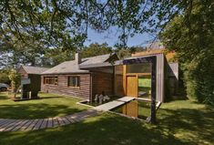 grand design house - like the wood/gravel path and burnt larch cladding