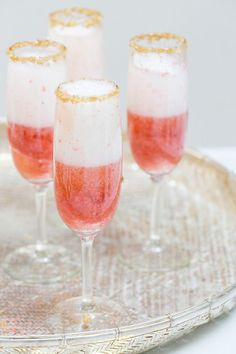 Champagne and Strawberries with a Gold Rim Puree 1/4 cup strawberries with 1 teaspoon sugar. Wet the rim of the Champagne glasses and dip into gold sugar or sprinkles. Add a tablespoon of strawberry puree into the bottom of each glass. Top with Champagne.