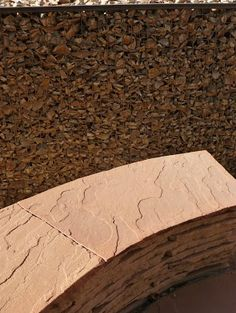 Curved flagstone banco and gabion wall