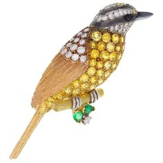 Fine Yellow Sapphire Diamond Gold Bird Brooch | From a unique collection of vintage brooches at https://www.1stdibs.com/jewelry/brooches/brooches/