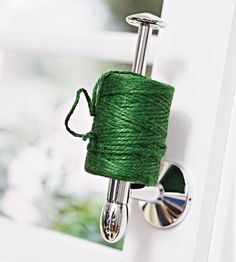 Turn a toilet paper holder on it's side to keep track of twine in the shed!