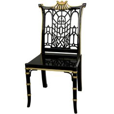 Crafted with solid wood, this chair showcases a distinctive pagoda top back with unique oriental style lattice. An exceptional, medium gloss fine Chinese black lacquer is accented with elegant hand-painted gold detail for a finishing touch.