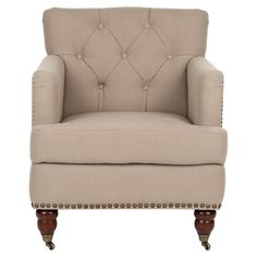 Button-tufted taupe arm chair with castered birch wood feet and nailhead trim.  Product: ChairConstruction Material:...