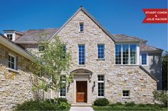 This home in the suburbs of Chicago designed by Stuart Cohen & Julie Hacker Architects has a formal lannon stone front, cut stone classical entryway and a dark stained wooden front door for a neo-classical look.