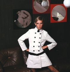 Twiggy in a white mac photographed by Ron Falloon in 1967