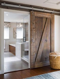 Reused barn door for bathroom :) Love it how the old meets new!