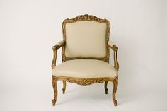 Beautiful 19th Century Louis XV style carved gilt wood fauteuil, newly  upholstered in fine German bone colored leather.  29w x 24d x 39.5h