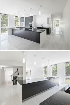 The dark cabinetry and kitchen island contrast with the white walls and marbled floor.