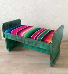 Unique green wooden bench upholstered with the famous Mexican 'Serape' fabric. Traditional sturdy fabric from Mexico. Details: Origin: cm wide, deep and high. Price in USD Ships worldwide Painting Old Furniture, Refurbished Furniture, Diy Furniture Projects, Furniture Makeover, Painted Benches, Baby Fabric, Western Furniture, Upholstered Bench, Cool Chairs