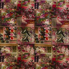 Barcelona Velvet Fabric An extraordinary velvet fabric, printed with a patchwork of fantasy blooms, divided by bands of small decorative motifs, shown in red, pink and green.