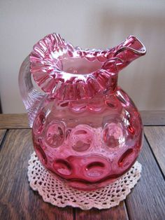 1940's Vintage Fenton LG Wright Large Depression Cranberry Glass Dot Optic Water PitcherThe pattern is called Thumbprint. It has a crimped ruffled rim and a fancy extruded, clear hand blown applied handle.$195