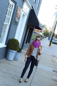 Love the outfit: striped loose blouse,camel blazer, dark-wash jeans, bright-colored scarf, patterned heels