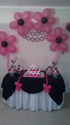 DIY girly party decorations. Use two contrasting table cloths.  Add swags to the top table cloth with contrasting colored ribbon. Make this to match your theme colors. Another great idea is to make flowers out of balloons.  Use these ideas for birthday, garden or tea party. Also makes a great addition to your bridal or baby shower decor.