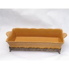 <li>Dress up your kitchen or dining room with serveware from Certified International</li><li>Ceramic tableware is available in renaissance gold color option</li><li>Earthenware baking dish comes with a stand so it's ideal for oven-to-table use</li>