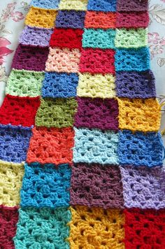 Join as you go granny squares. No tutorial, but very easy & super cute!