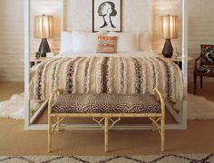 We love a bench at the foot of the bed. Cheetah print is even better!