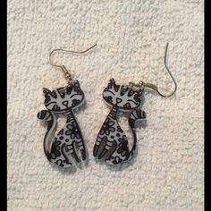 NWOT Cute cat earrings! Black and white acrylic cat earrings. So adorable!!! Jewelry Earrings