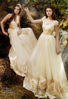 Google Image Result for http://data.whicdn.com/images/6438368/off-white-ivory-wedding-dresses-2011_large.jpg