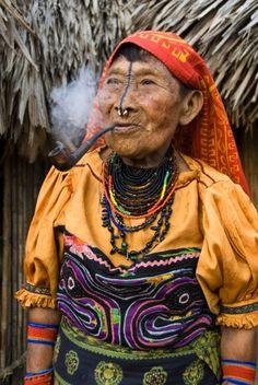 Panama | Kuna woman smoking a pipe, Playon Chico Village, San Blas Islands (Kuna Yala Islands) | © Richard Maschmeyer