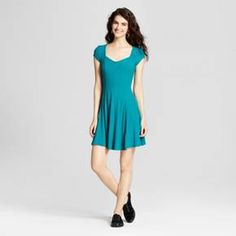 Pop some color into your wardrobe with the Fit-and-Flare Ribbed Skater Dress from Mossimo Supply Co.™ The sweetheart neckline and fitted top seamlessly transition into a free-flowing skirt for a flattering, feminine look. With the simple ribbed bodice and solid color, you can accessorize this dress in a multitude of ways. Throw on your favorite pair of lace-up sneaks and a choker for an edgier look, or slip into some strappy heels for a girly, sassy style.